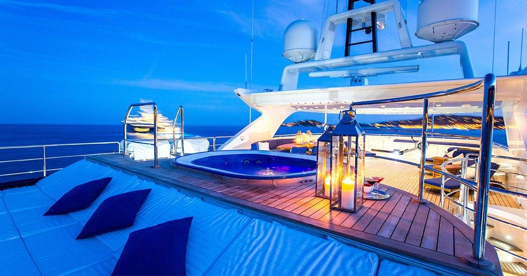 sundeck on board motor yacht MISCHIEF lights up at night
