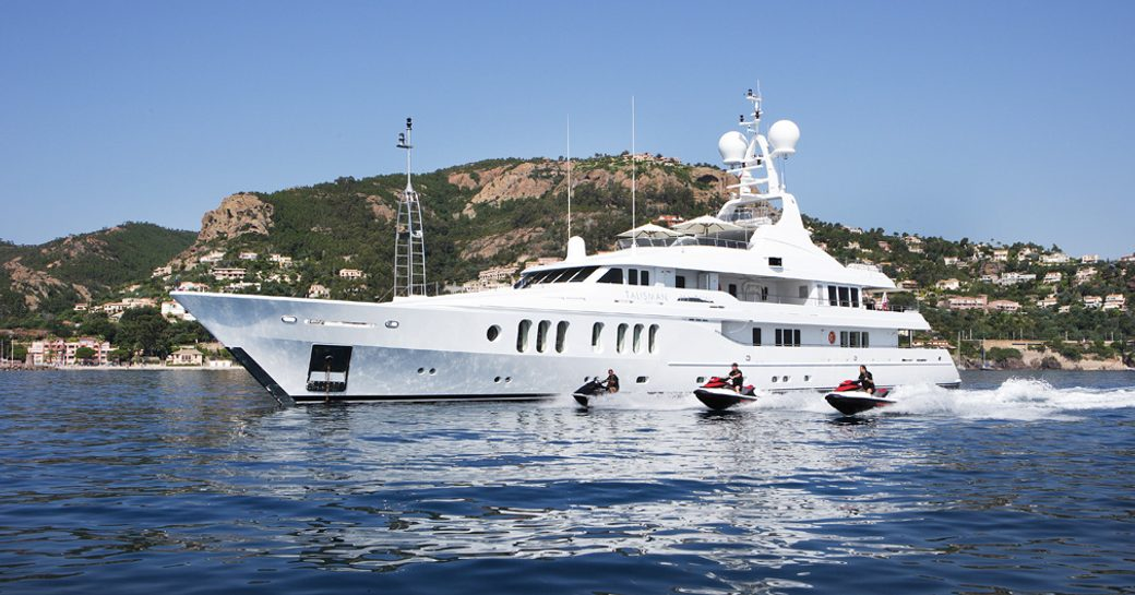 Superyacht 'Talisman Maiton' seen from the starboard side with jetskis beside it