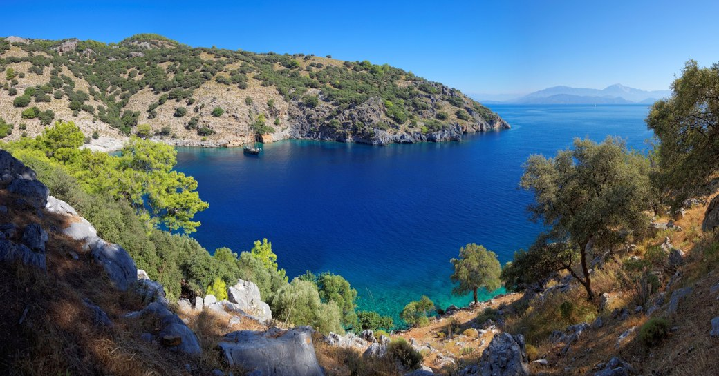 secluded bay with turquoise waters in the superyacht cruising grounds of Turkey