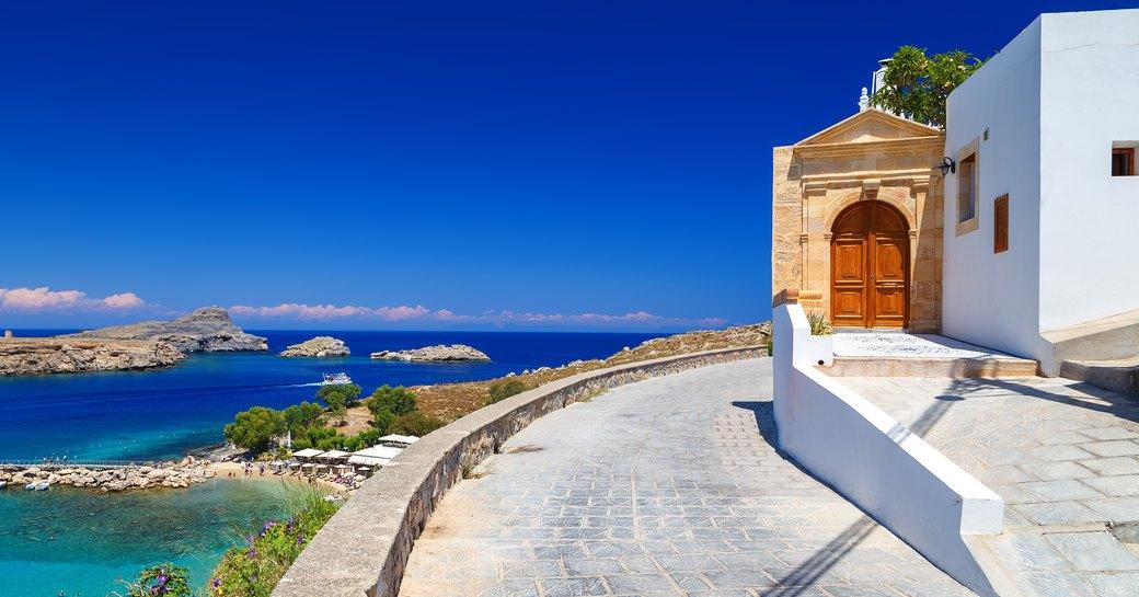 chapel overlooking little bay in greece