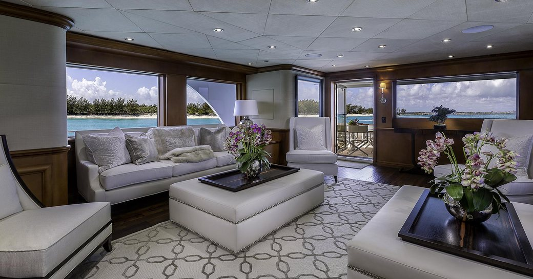 sofas and armchairs in the timeless-styled main salon aboard motor yacht M3