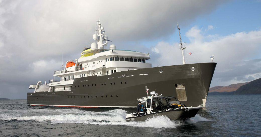 yersin explorer yacht with tender alongside