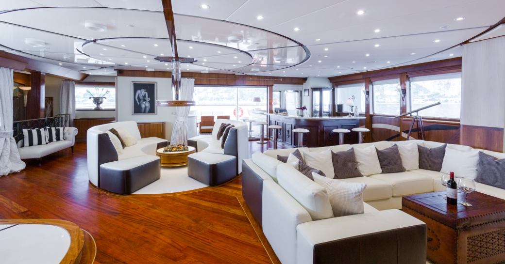 Bright white furnishings situated inside superyacht LEGEND
