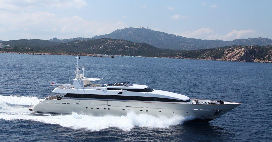 Motor yacht HEMILEA from Baglietto underway, with Mediterranean coastlines in background