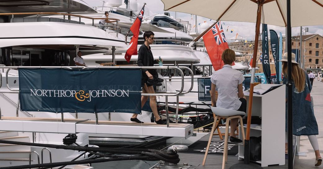 visitor steps of superyacht in OneOcean Port Vell at The Superyacht Show