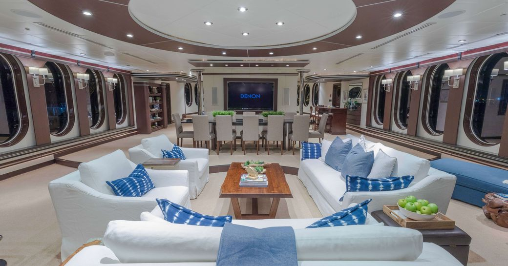 seating area and dining table in the skylounge aboard expedition yacht GLOBAL