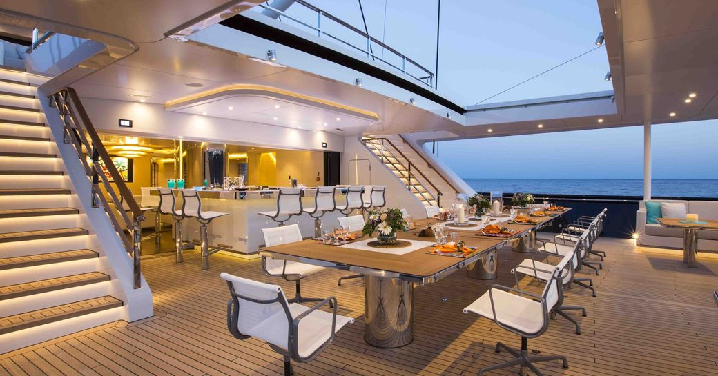 Dining table and bar area of luxury yacht AQUIJO