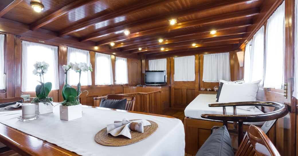 superyacht over the rainbow over the rainbow entertainment area with table and tv