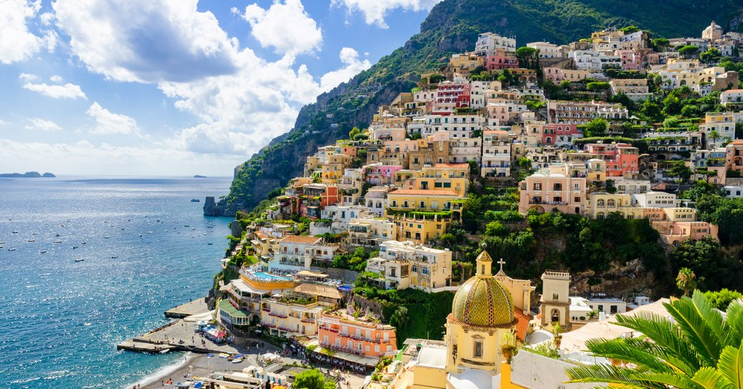 the candy coloured buildinsg of the hot charter yacht destination positano