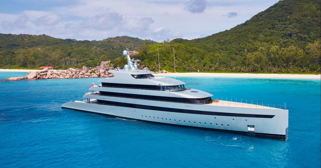 superyacht SAVANNAH anchored in the idyllic waters of the Caribbean on a charter vacation