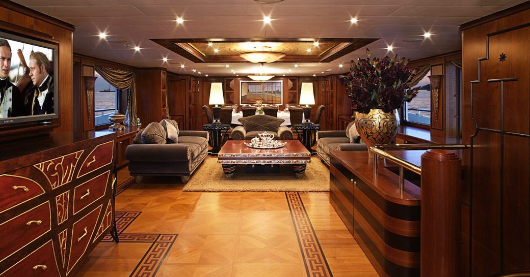 eclectic styling in the warm and welcoming main salon of superyacht DENIKI