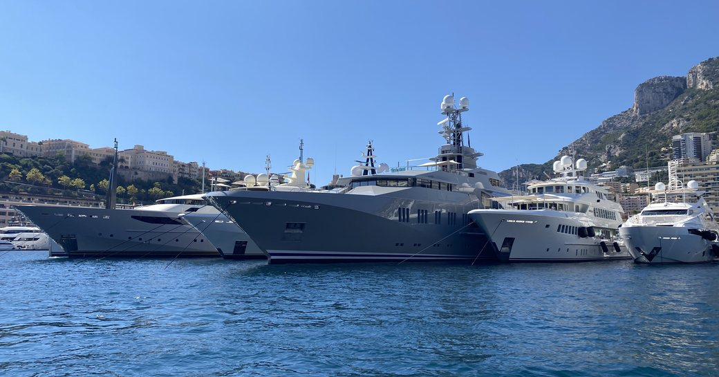 Line of yachts in-show at the Monaco Yacht Show 2021