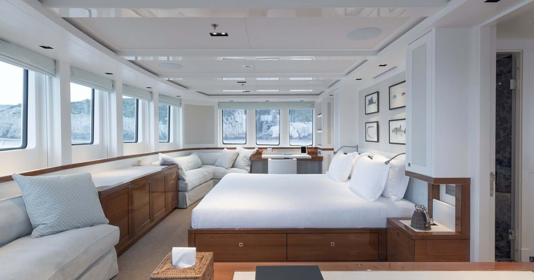 Large main cabin on explorer yacht 'Blue II' with double bed and lots of windows