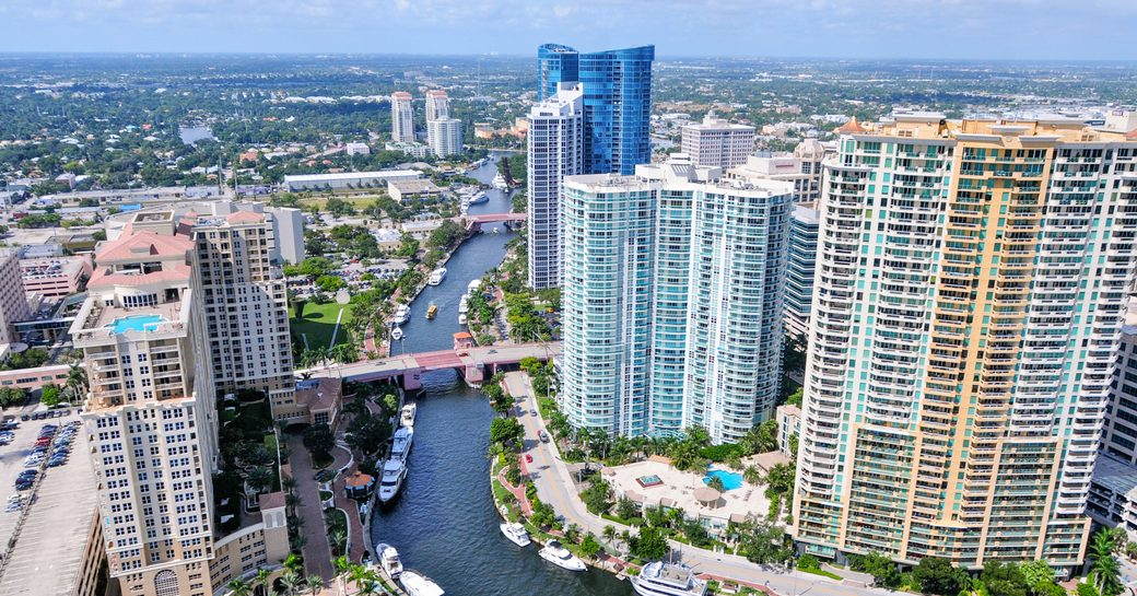 Overview of Fort Lauderdale, elevated view of causeway surrounded by towering hotels and cosmopolitan backdrop.