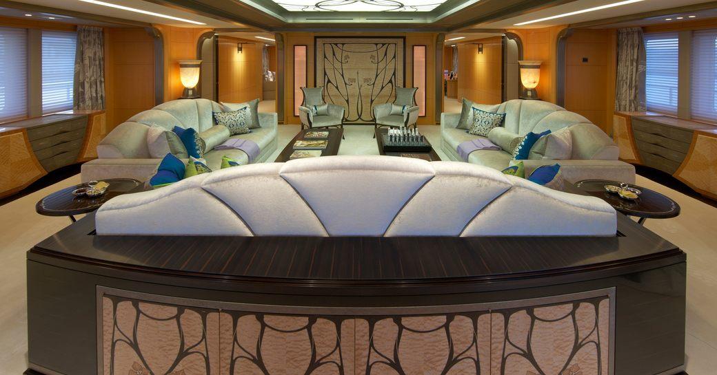 deep sofas in the Art Nouveau-themed main salon of superyacht AMARYLLIS