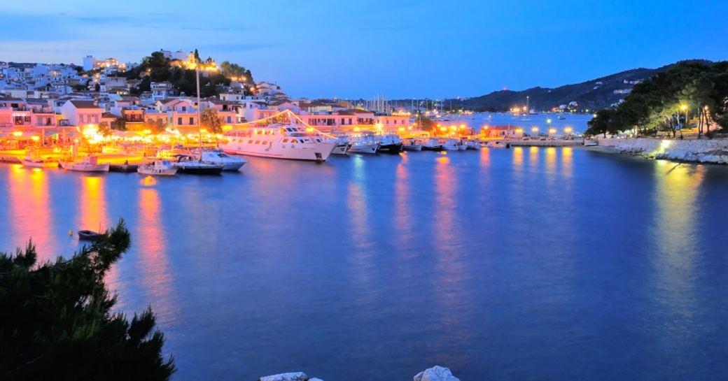 Beautiful Greek port setting at night