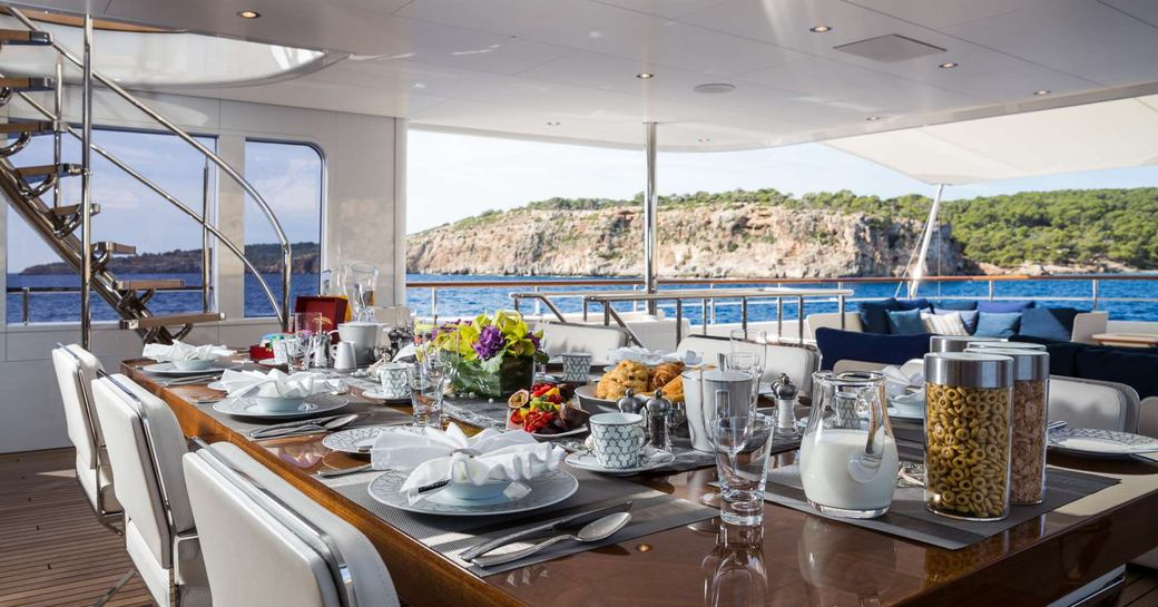 Dining space on aft deck on luxury yacht GO