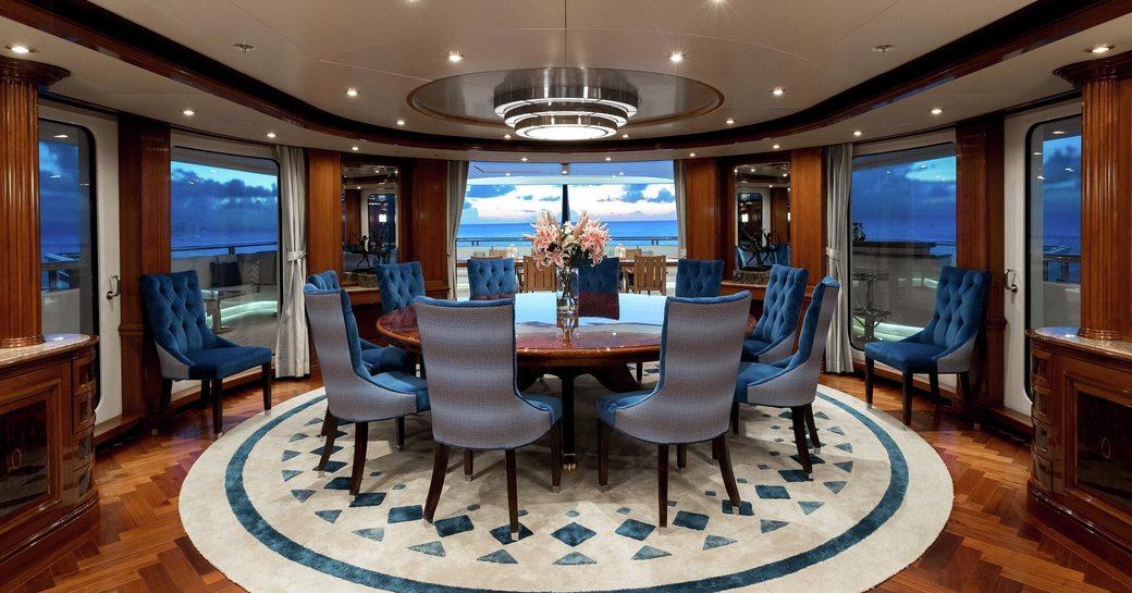 circular enclosed dining table on bridge deck aft of superyacht TITANIA