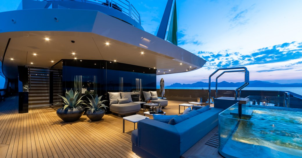 swimming pool and lounge area on the aft deck of luxury yacht SOLO