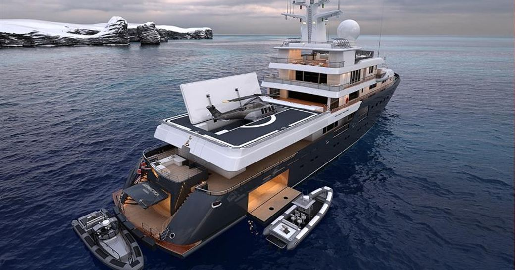 superyacht planet nine aerial shot with helicopter and rib tenders surrounding, views of antarctica in background
