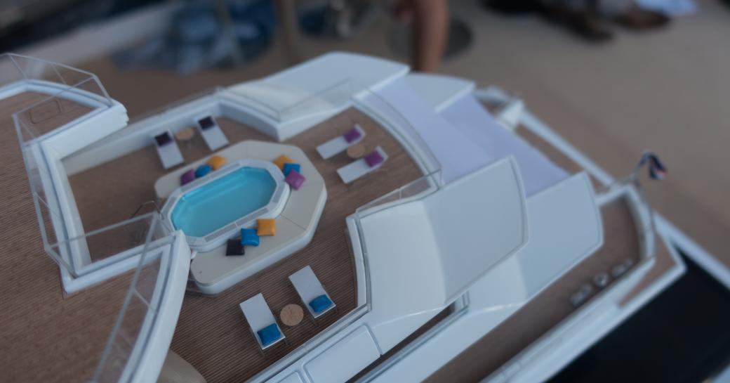 pool area on the upper deck aft of superyacht Artefact
