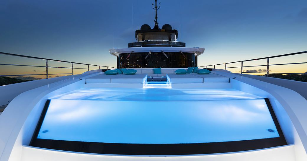 the infinity pool on-bard superyacht EVA. 4EVA BUILT WITH MOOD LIGHTING AND LOCATED ON HER FORWARD DECK
