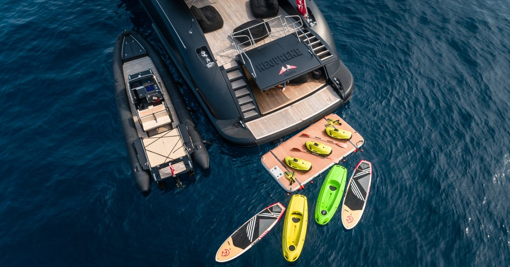 Aft view of charter yacht NEOPRENE from above with water toys behind