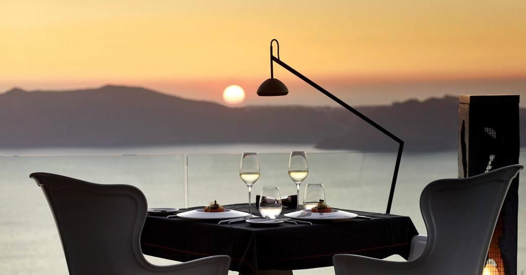Fine dining experience overlooking a beautiful sunset in Santorini