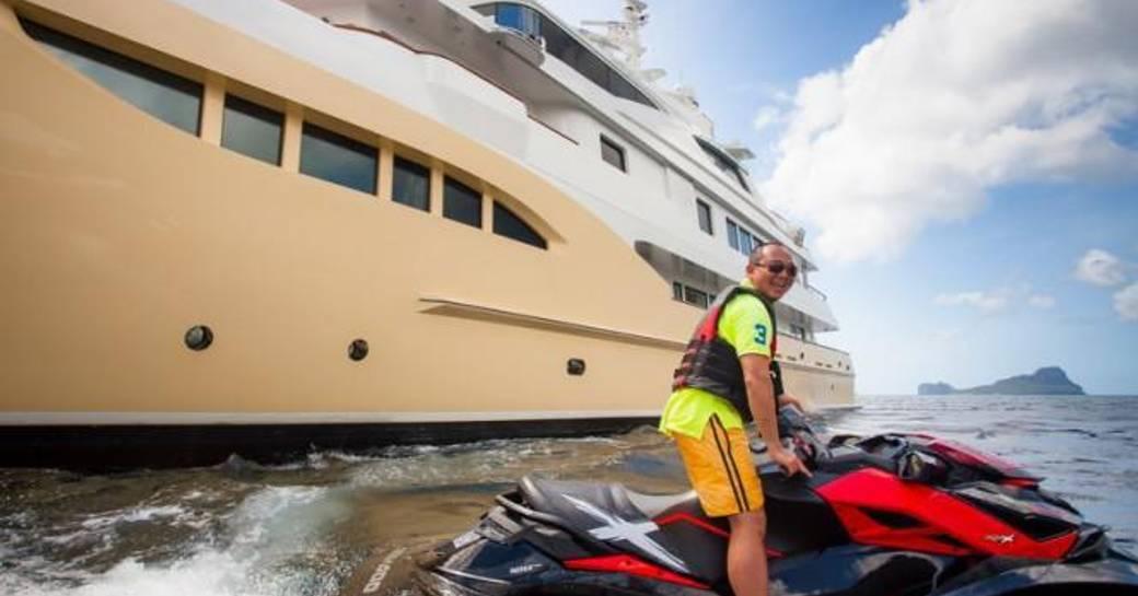 A guest enjoys a Jetski on a charter vacation