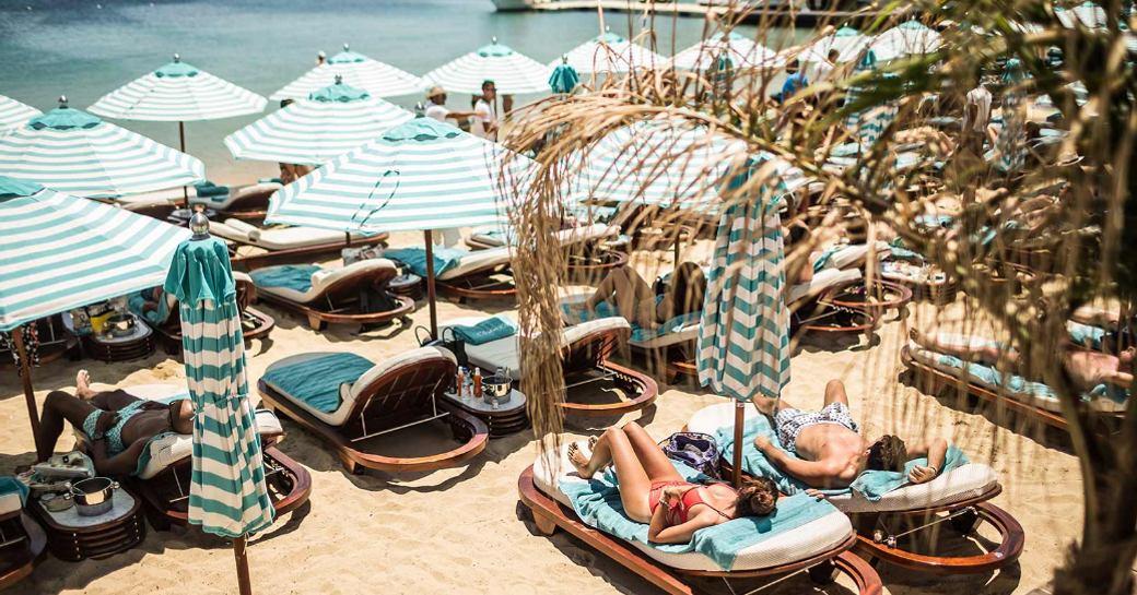 sun loungers at Nammos beach club, Mykonos, Greece