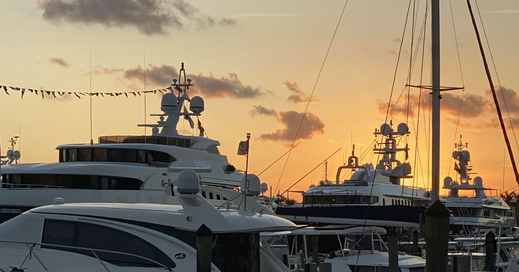 a beautiful sunset casting the motor yachts at FLIBS 2019 in a demure lights as the event reaches its end