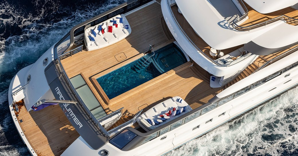 aerial shot of 12 meter luxury swimming pool and swimming platform of charter yacht Madsummer