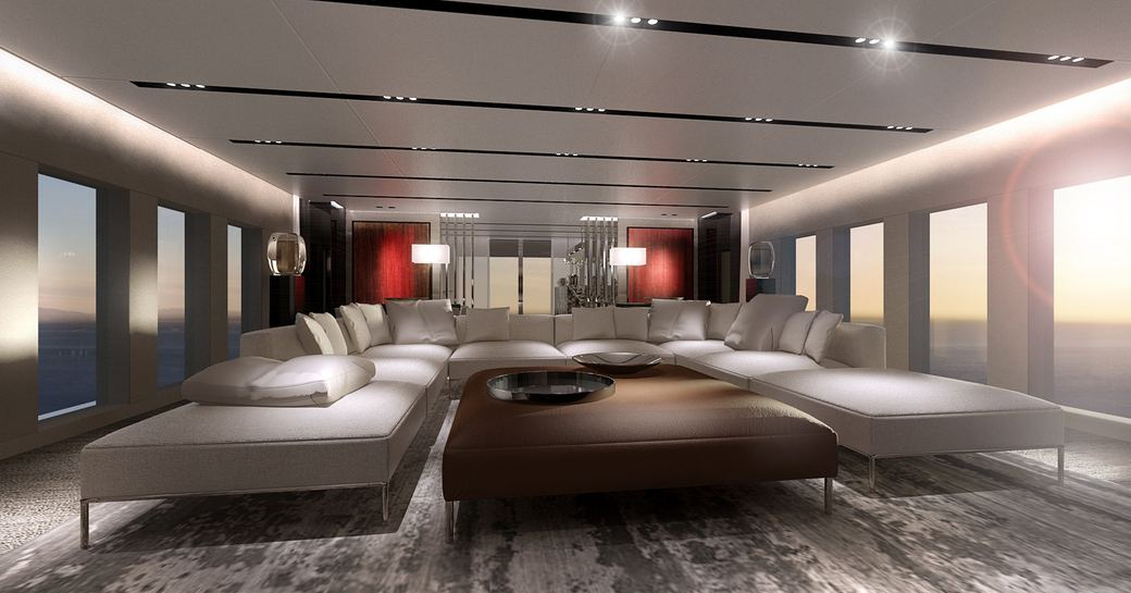 c-shaped sofa in main salon on board superyacht OURANOS