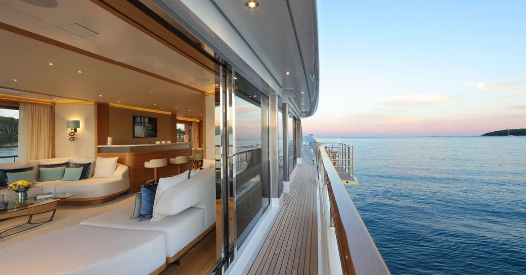 full-length windows slide open into the main salon aboard luxury yacht SOLIS