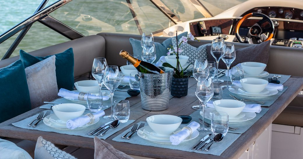 sundeck on luxury sunseeker yacht chess with elegant tablescape