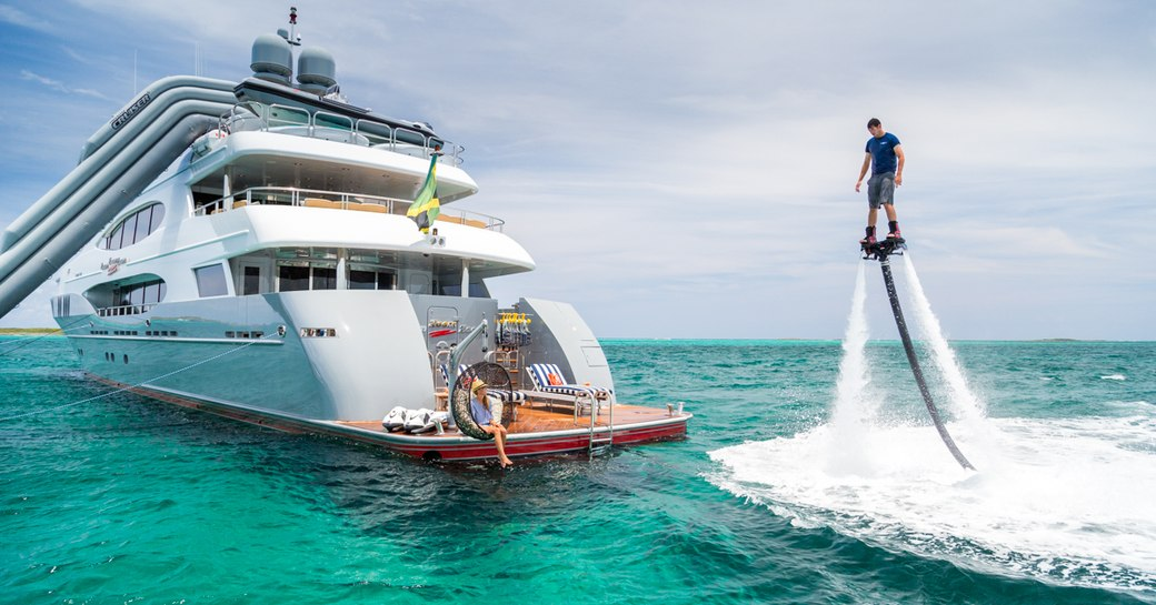 A charter guest playing with toys on board M/Y Zoom Zoom Zoom