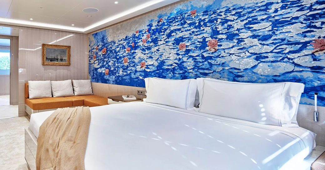 master cabin on luxury yacht soaring, with blue painted headboard