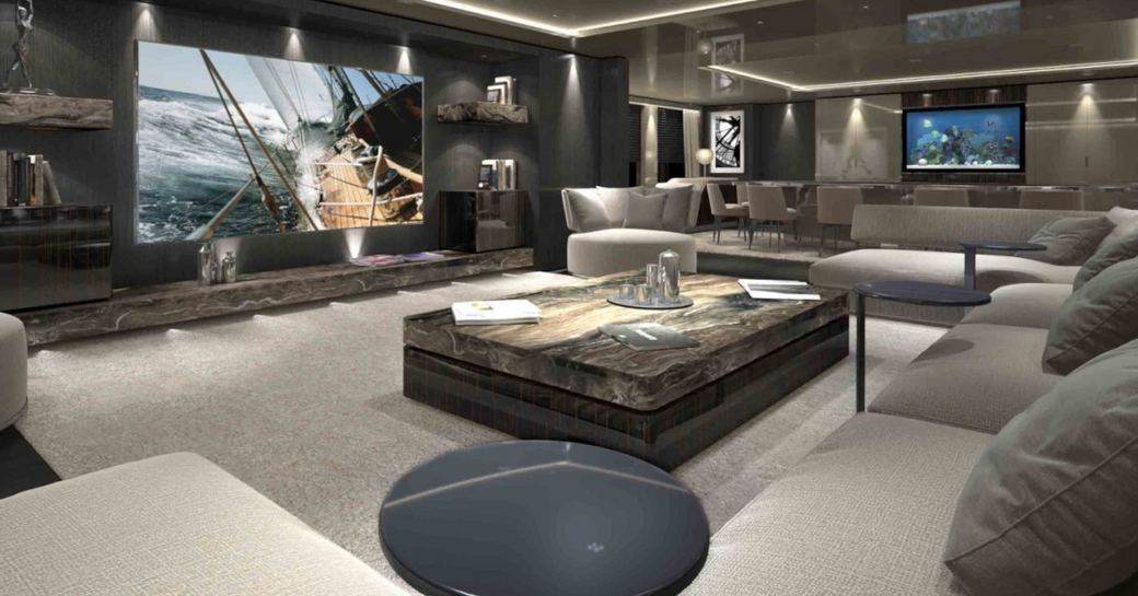 large lounge area with huge TV and dining table in main salon on board charter yacht SOLO