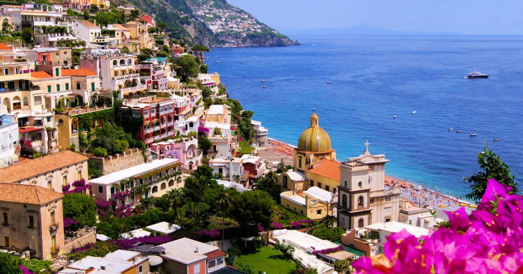 amalfi coast view over positano, with sea in background
