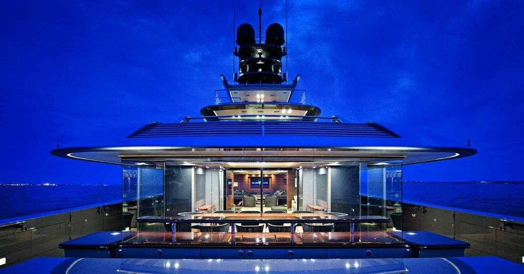 view of aft deck aboard motor yacht 'Silver Fast' at night