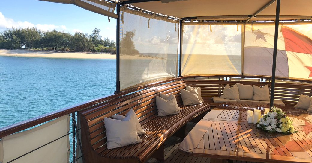 upper deck aft of luxury yacht over the rainbow