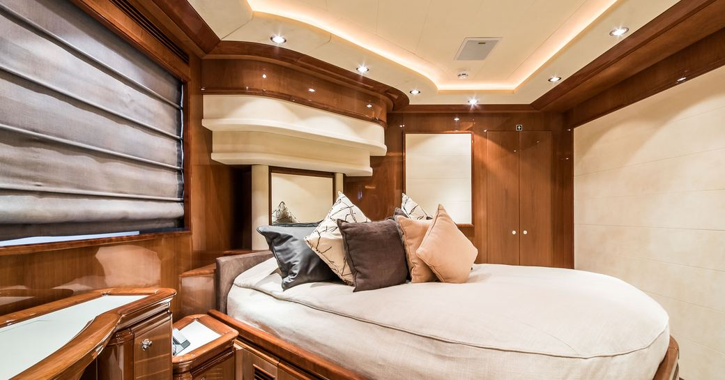 Large cabin on Superyacht Queen of Sheba with lightly colored bed