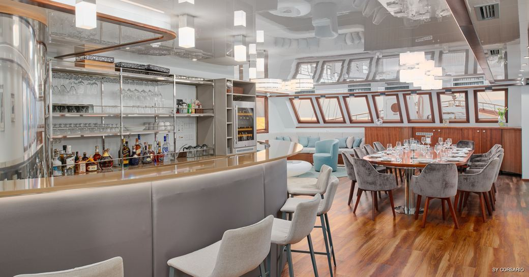 Bar and formal dining area onboard SY Corsario