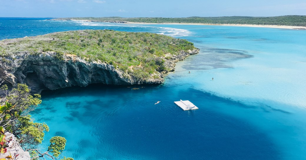Blue hole from above, sandy beaches in background