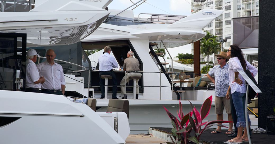 clients and dealers on board small production yacht at miami yacht show