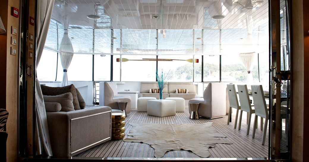 luxury charter yacht tango salon leading to al fresco dining and deck seating area