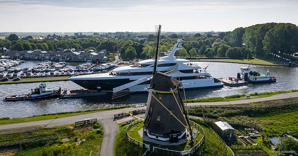 podium superyacht passes by windmills of the netherlands