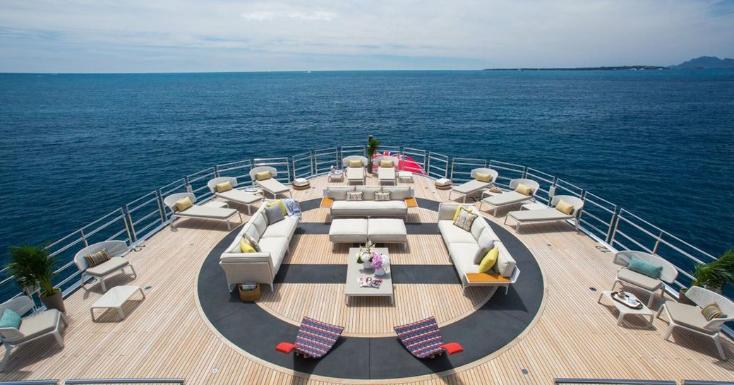 Foredeck helipad with sun loungers onboard MY Naia