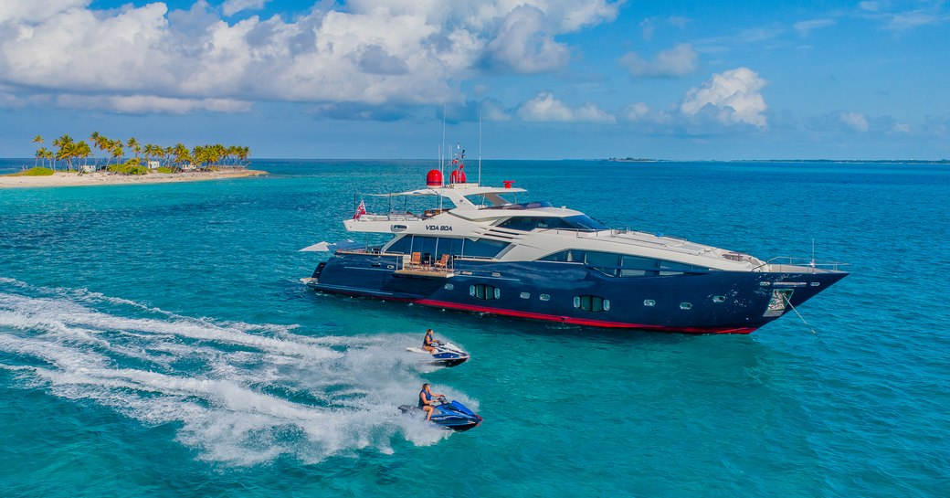 luxury yach vida boa surrounded by clear water in the bahamas