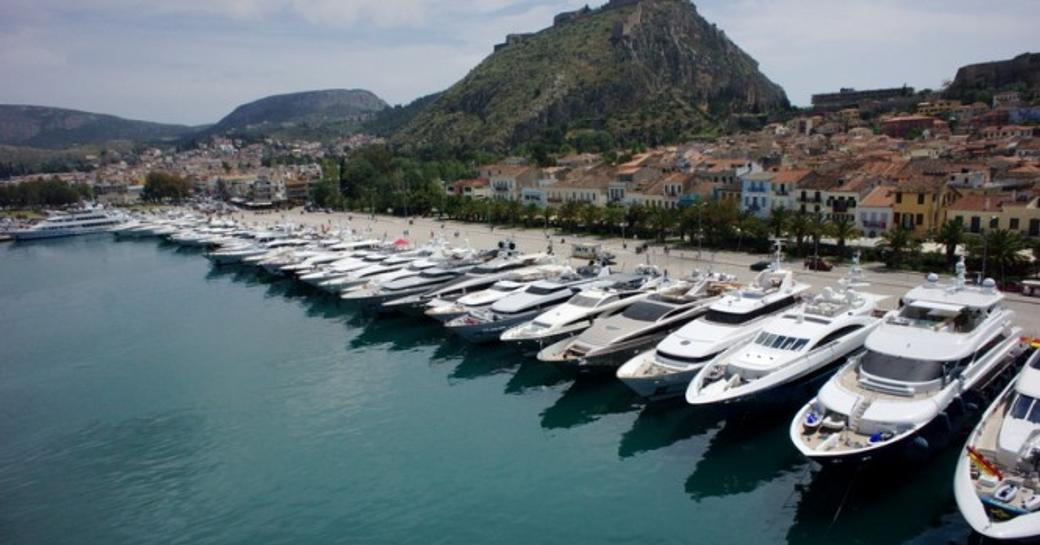 charter yachts moored in line at the Mediterranean Yacht Show.
